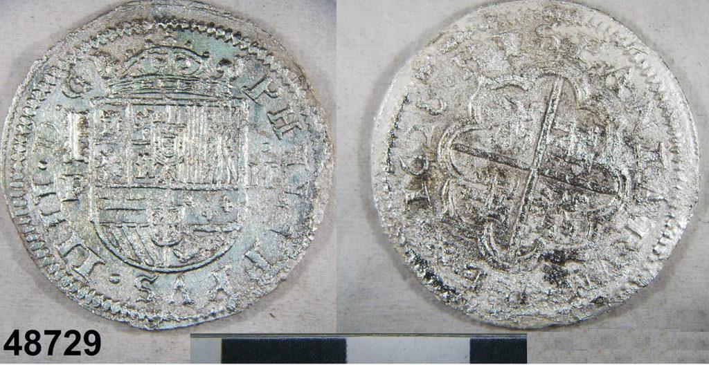 Moneda a encunyada amb la tècnica del molinet al Real Ingenio de Segovia.  2 rals de plata de Felip IV, revers data de 1628. Assajador Pedro Enríquez.